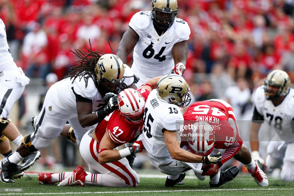 Warren Herring #45 and Vince Biegel #47 of the Wisconsin Badgers sack Rob Henry #15 of the Purdue Boilermakers during the game at Camp Randall Stadium on September 21, 2013 in Madison, Wisconsin.