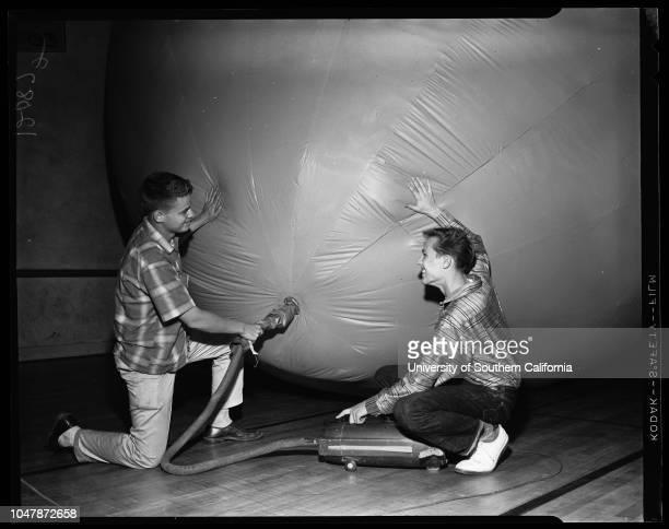 Warren Hillman -- 18 years , 30 March 1957. Duncan Vanderbilt .;Supplementary material reads: 'Warren Hilman of Santa Ana operates valve on his red...