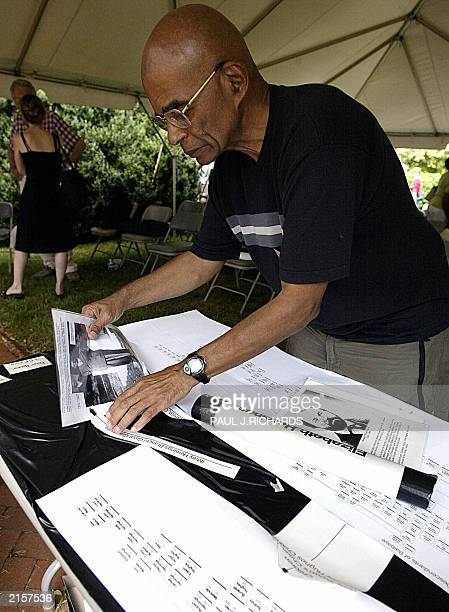 Warren Hughes a descendant on the Betty Brown line of the family packs up genealogy charts and materials related to the author of the Declaration of...