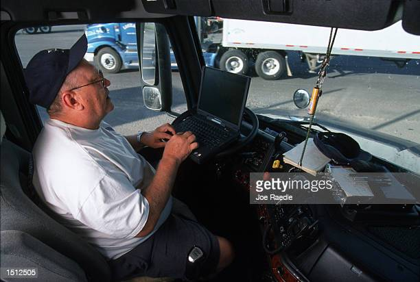 Warren Hunter who has been trucking for 3 years uses a GPS system hooked up to his computer to plan his delivery route May 29 2000 in his Volvo 770...