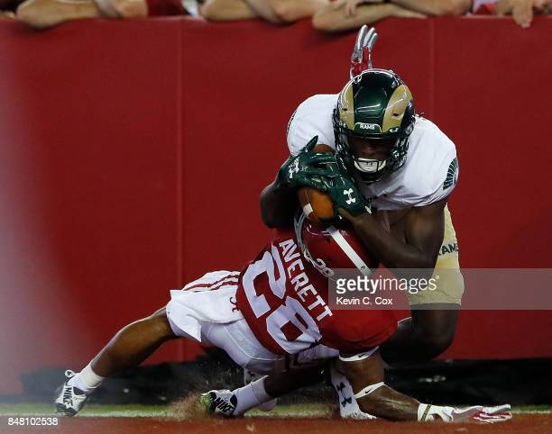 Warren Jackson of the Colorado State Rams pulls in this touchdown reception against Anthony Averett of the Alabama Crimson Tide at Bryant-Denny...