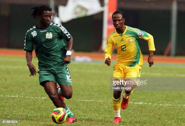 Warren Kanu of Sierra Leone competes with Teko Modise of South Africa during the AFCON and FIFA 2010 World Cup Qualifier match between Sierra Leone...