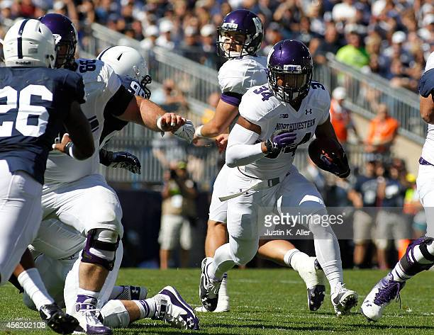 Warren Long of the Northwestern Wildcats rushes in the first half against the Penn State Nittany Lions during the game on September 27 2014 at Beaver...