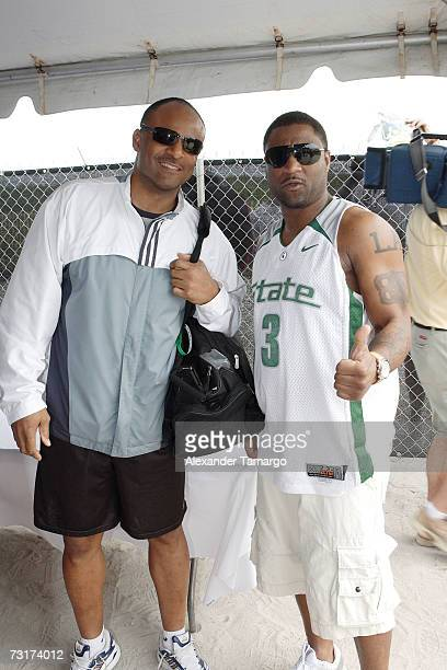 Warren Moon and Andre Rison pose in the VIP tent during the Celebrity Beach Bowl on February 1 2007 in Miami Beach Florida