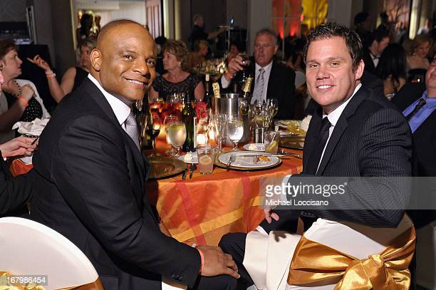 Warren Moon and Bob Guiney attend the Unbridled Eve Gala for the 139th Kentucky Derby at The Galt House Hotel Suites' Grand Ballroom on May 3 2013 in...