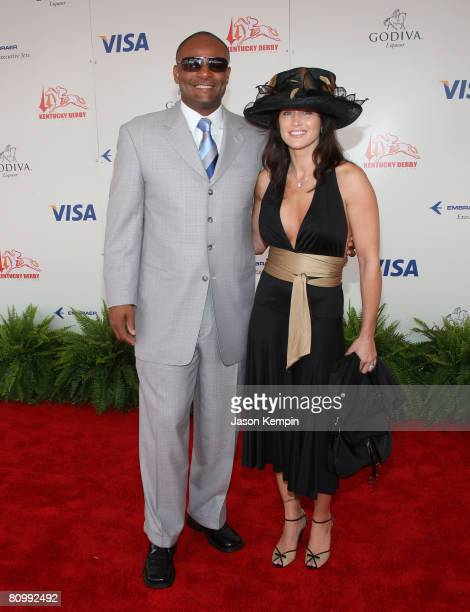 Warren Moon and wife Mandy Moon attend the 134th Kentucky Derby at Churchill Downs on May 3 2008 in Louisville Kentucky