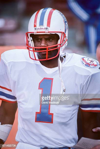 Warren Moon of the Houston Oilers waits on the sidelines during an NFL game against the Los Angeles Rams played on December 9 1984 at Anaheim Stadium...