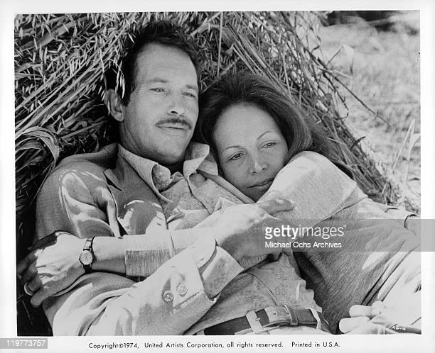 Warren Oates and Isela Vega holding each other in a scene from the film 'Bring Me the Head of Alfredo Garcia' 1974