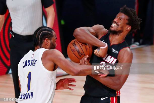 J Warren of the Indiana Pacers defends Jimmy Butler of the Miami Heat as he drives to the basket during the second half of Game 3 of an NBA...