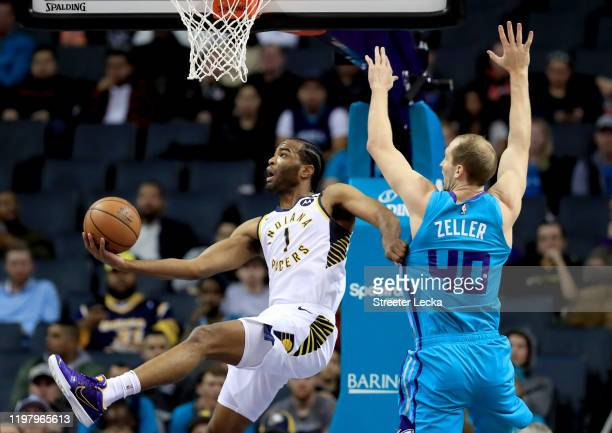 J Warren of the Indiana Pacers drives to the basket against Cody Zeller of the Charlotte Hornets during their game at Spectrum Center on January 06...