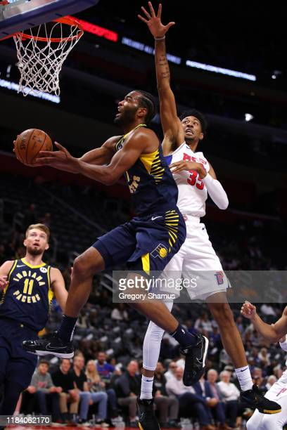 J Warren of the Indiana Pacers drives to the basket past Christian Wood of the Detroit Pistons during the first half at Little Caesars Arena on...