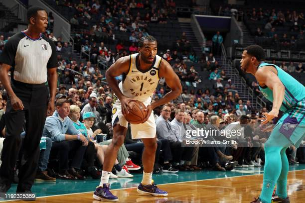 J Warren of the Indiana Pacers handles the ball during the game against the Charlotte Hornets on January 6 2020 at Spectrum Center in Charlotte North...