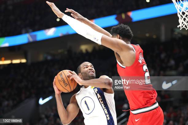J Warren of the Indiana Pacers takes a shot against Hassan Whiteside of the Portland Trail Blazers in the fourth quarter during their game at Moda...