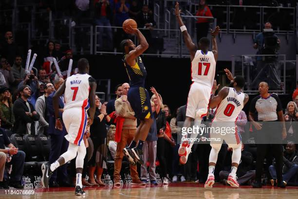 J Warren of the Indiana Pacers tries to hit a game winning three pointer at the buzzer against Tony Snell of the Detroit Pistons at Little Caesars...