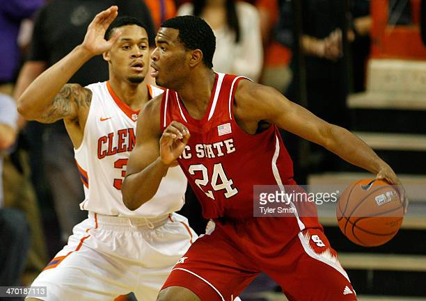 J Warren of the North Carolina State Wolfpack drives on KJ McDaniels of the Clemson Tigers during the game at Littlejohn Coliseum on February 18 2014...