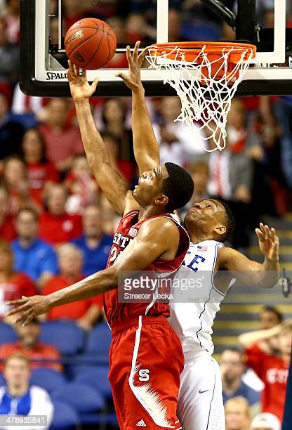 J Warren of the North Carolina State Wolfpack drives to the basket against Jabari Parker of the Duke Blue Devils during the semifinals of the 2014...