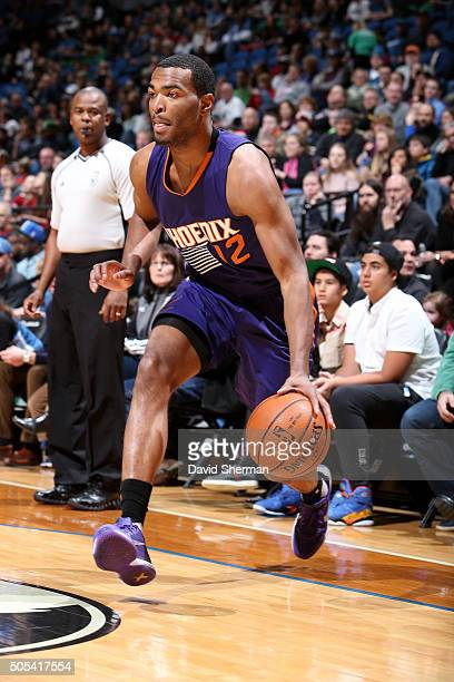 J Warren of the Phoenix Suns drives to the basket during the game against the Minnesota Timberwolves on January 17 2016 at Target Center in...