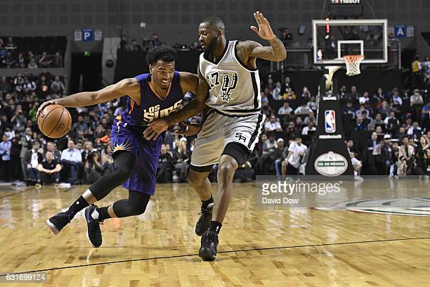 Warren of the Phoenix Suns drives to the basket while guarded by Jonathon Simmons of the San Antonio Spurs as part of NBA Global Games at Arena...