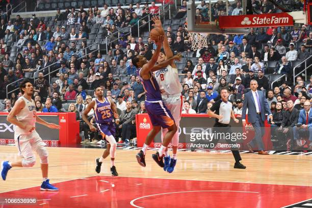 J Warren of the Phoenix Suns goes to the basket against Danilo Gallinari of the LA Clippers on November 28 2018 at STAPLES Center in Los Angeles...