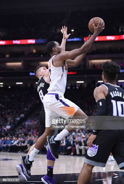 Warren of the Phoenix Suns goes up for a layup over Bogdan Bogdanovic of the Sacramento Kings during an NBA basketball game at Golden 1 Center on...