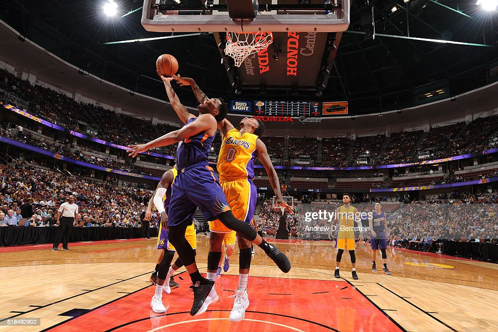 T.J. Warren #12 of the Phoenix Suns goes up for a shot against Nick Young #0 of the Los Angeles Lakers during a preseason game on October 21, 2016 at Honda Center in Anaheim, California.