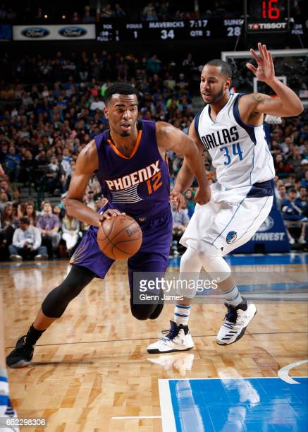 Warren of the Phoenix Suns handles the ball against Devin Harris of the Dallas Mavericks on March 11 2017 at the American Airlines Center in Dallas...