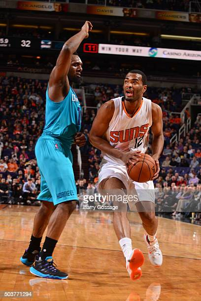 J Warren of the Phoenix Suns handles the ball against the Charlotte Hornets on January 6 2016 at US Airways Center in Phoenix Arizona NOTE TO USER...
