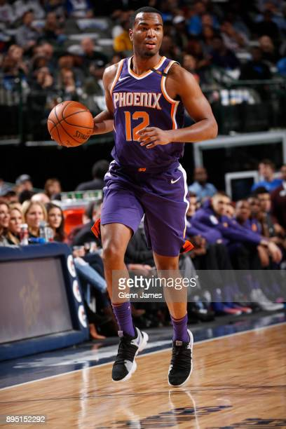 Warren of the Phoenix Suns handles the ball against the Dallas Mavericks on December 18 2017 at the American Airlines Center in Dallas Texas NOTE TO...