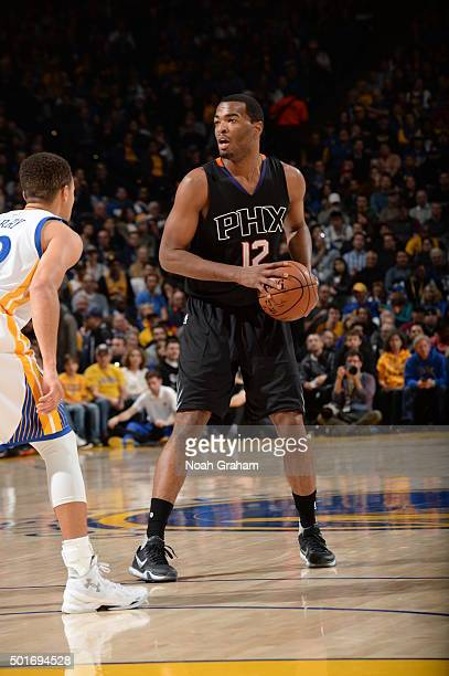 J Warren of the Phoenix Suns handles the ball against the Golden State Warriors on December 16 2015 at Oracle Arena in Oakland California NOTE TO...
