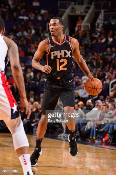 Warren of the Phoenix Suns handles the ball against the Washington Wizards on December 7 2017 at Talking Stick Resort Arena in Phoenix Arizona NOTE...