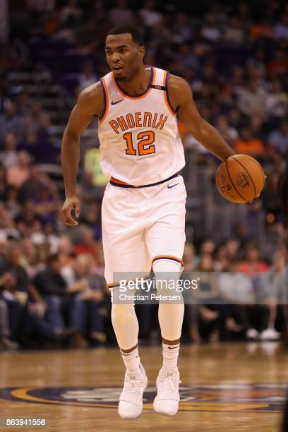 Warren of the Phoenix Suns handles the ball during the first half of the NBA game against the Portland Trail Blazers at Talking Stick Resort Arena on...
