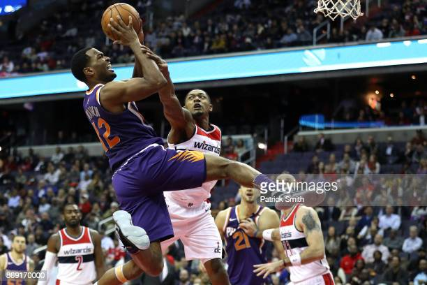 Warren of the Phoenix Suns is fouled by Bradley Beal of the Washington Wizards during the second half at Capital One Arena on November 01 2017 in...