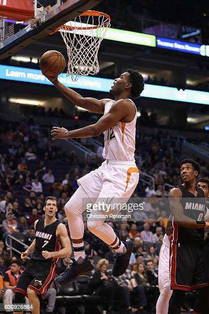 Warren of the Phoenix Suns lays up a shot against the Miami Heat during the second half of the NBA game at Talking Stick Resort Arena on January 3...