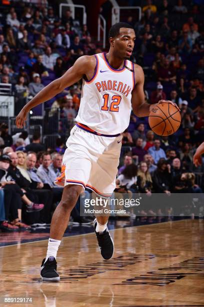 Warren of the Phoenix Suns moves to pass the ball against the San Antonio Spurs on December 9 2017 at Talking Stick Resort Arena in Phoenix Arizona...