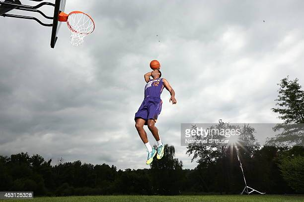 J Warren of the Phoenix Suns poses for a portrait during the 2014 NBA rookie photo shoot on August 3 2014 at the Madison Square Garden Training...