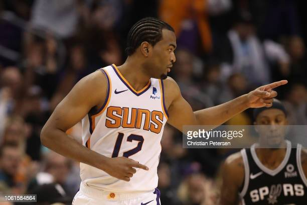 Warren of the Phoenix Suns reacts after hititng a threepoint shot during the second half of the NBA game against the San Antonio Spurs at Talking...