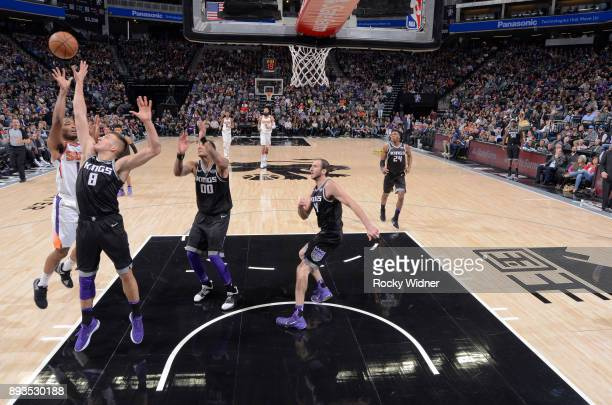 Warren of the Phoenix Suns shoots against Bogdan Bogdanovic of the Sacramento Kings on December 12 2017 at Golden 1 Center in Sacramento California...