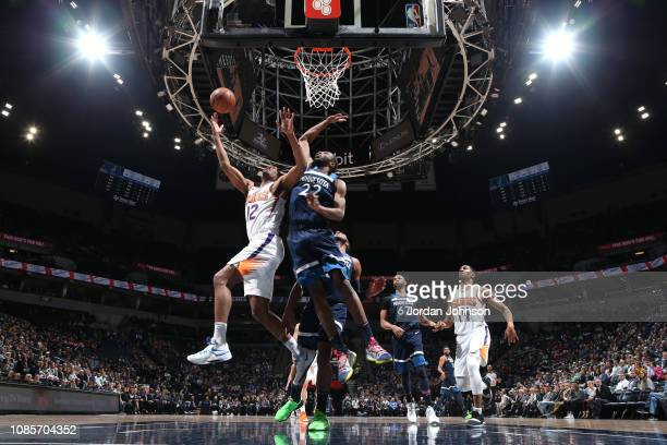 J Warren of the Phoenix Suns shoots the ball over Andrew Wiggins of the Minnesota Timberwolves on January 20 2019 at Target Center in Minneapolis...