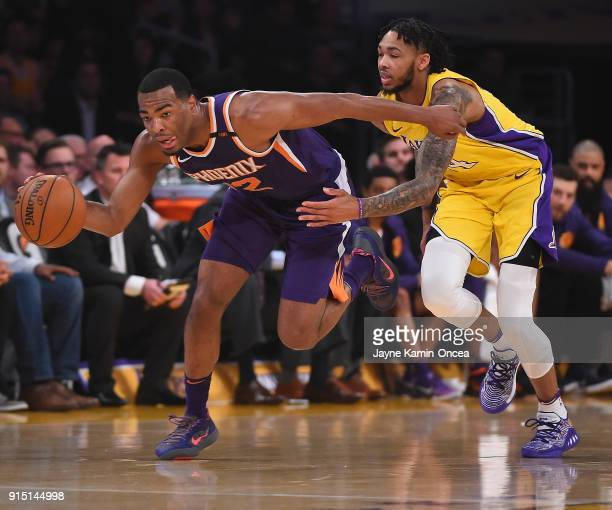 Warren of the Phoenix Suns steals the ball from Brandon Ingram of the Los Angeles Lakers and takes it down court for a basket in the first half of...