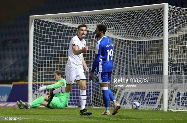 Warren O'Hora of Milton Keynes Dons celebrates after scoring his sides second goal as Jack Bonham and Vadaine Oliver of Gillingham FC react during...