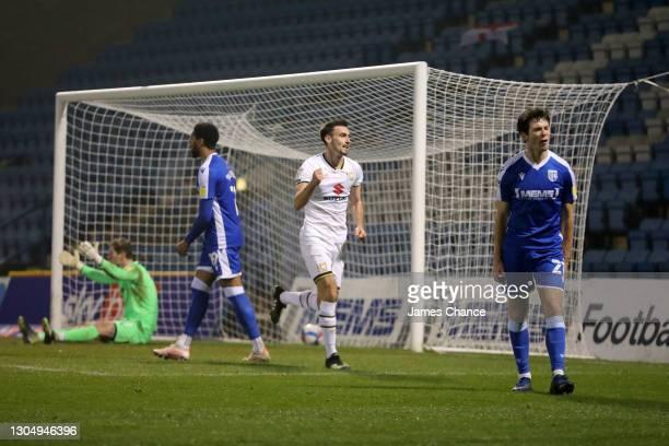Warren O'Hora of Milton Keynes Dons celebrates after scoring his sides second goal as Jack Bonham, Vadaine Oliver and Thomas O'Connor of Gillingham...