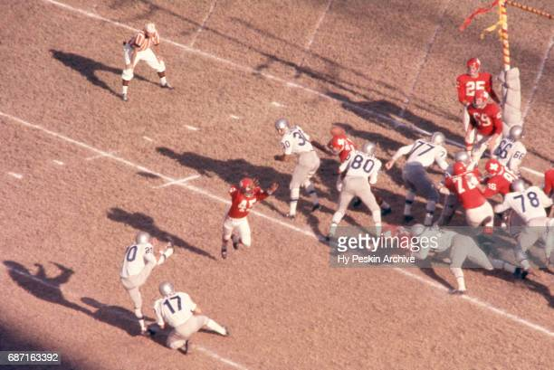 Warren Rabb of the Buffalo Bills holds the ball for Billy Atkins as Dave Grayson of the Dallas Texans tries to block the field goal attempt during an...