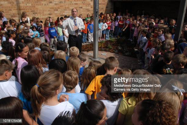 Warren Rudkin principal of Centennial Elementary School leads the student body in singing 'Happy Birthday' for the school's 30th birthday and...