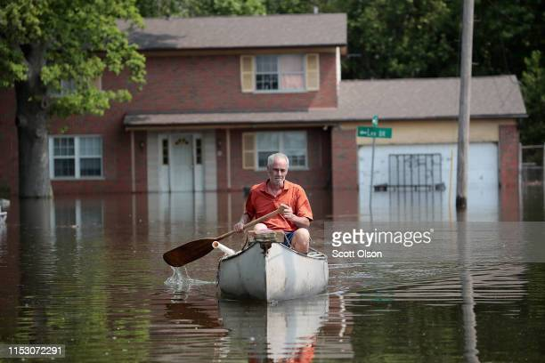 Warren Ryan canoes through floodwater from the Mississippi River to get to his home on June 1 2019 in West Alton Illinois The middlesection of the...
