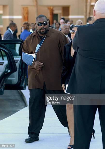 Warren Sapp former defensive lineman for coach Tony Dungy leaves the funeral for James Dungy December 27 2005 in Tampa Florida Officials say James...