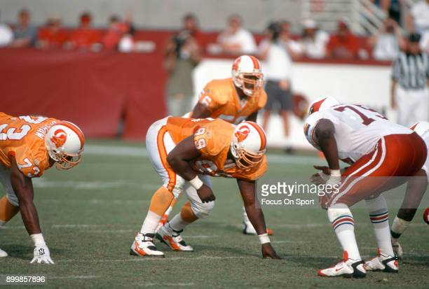 Warren Sapp of the Tampa Bay Buccaneers in action against the Arizona Cardinals during an NFL football game October 20 1996 at Sun Devil Stadium in...