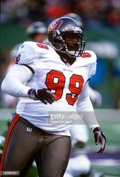 Warren Sapp of the Tampa Bay Buccaneers in action against the New York Jets during an NFL football game at The Meadowlands December 14 1997 in East...