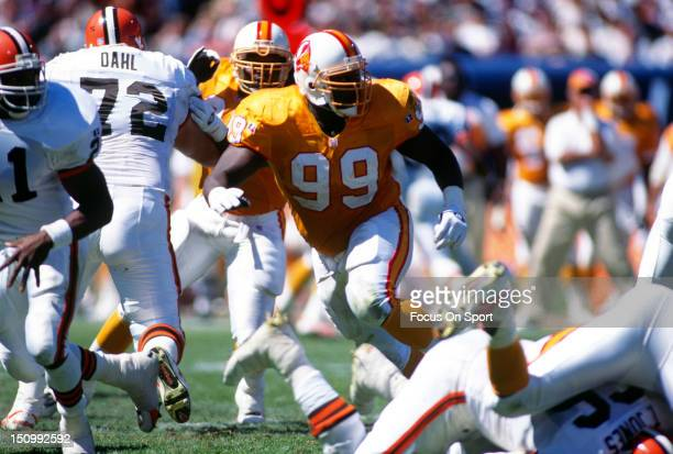 Warren Sapp of the Tampa Bay Buccaneers in pursues the play against the Cleveland Browns during an NFL football game at Cleveland Municipal Stadium...