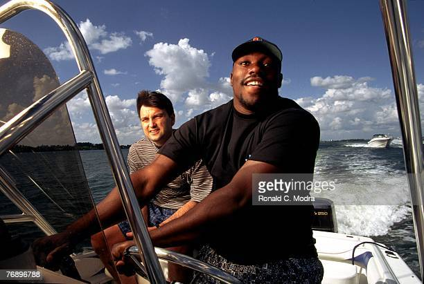 Warren Sapp of the Tampa Bay Buccaneers on a boat with sports agent Drew Rosenhaus on March 18 1995 in Miami Florida