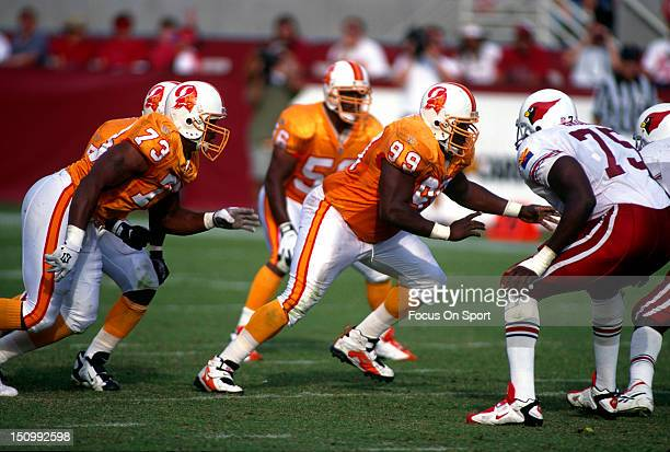 Warren Sapp of the Tampa Bay Buccaneers rushes against the Arizona Cardinals during an NFL football game at Sun Devil Stadium October 20 1996 in...